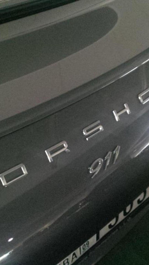 Porsche 911 goes to a paint shop, goes out with misspelled logo