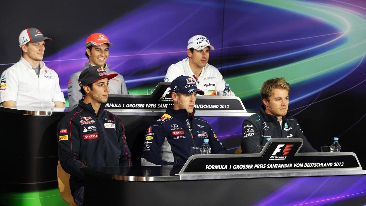 The FIA Press Conference (from back row (L to R)): Nico Hulkenberg (GER) Sauber; Sergio Perez (MEX) McLaren; Adrian Sutil (GER) Sahara Force India F1; Daniel Ricciardo (AUS) Scuderia Toro Rosso; Sebastian Vettel (GER) Red Bull Racing; Nico Rosberg (GER) M