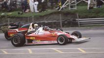 Gilles Villeneuve, Ferrari 312T2 passes Jody Scheckter, Wolf Ford