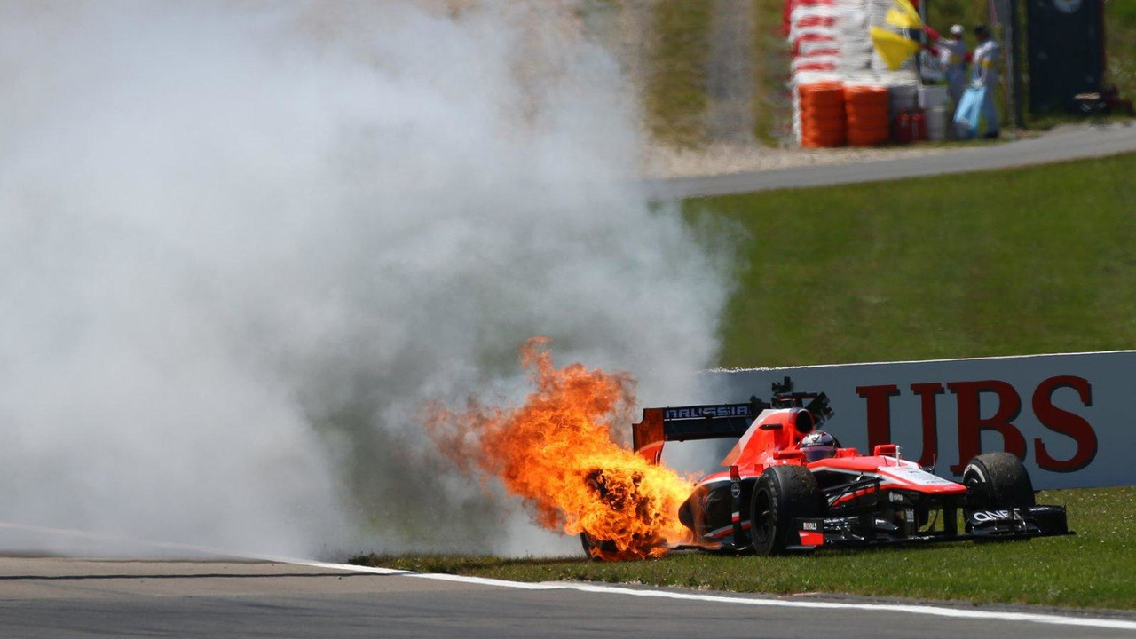 Jules Bianchi Marussia MR02 catches fire after stopping 07.07.2013 German Grand Prix