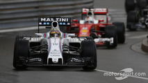 Felipe Massa, Williams FW38, leads Sebastian Vettel, Ferrari SF16-H