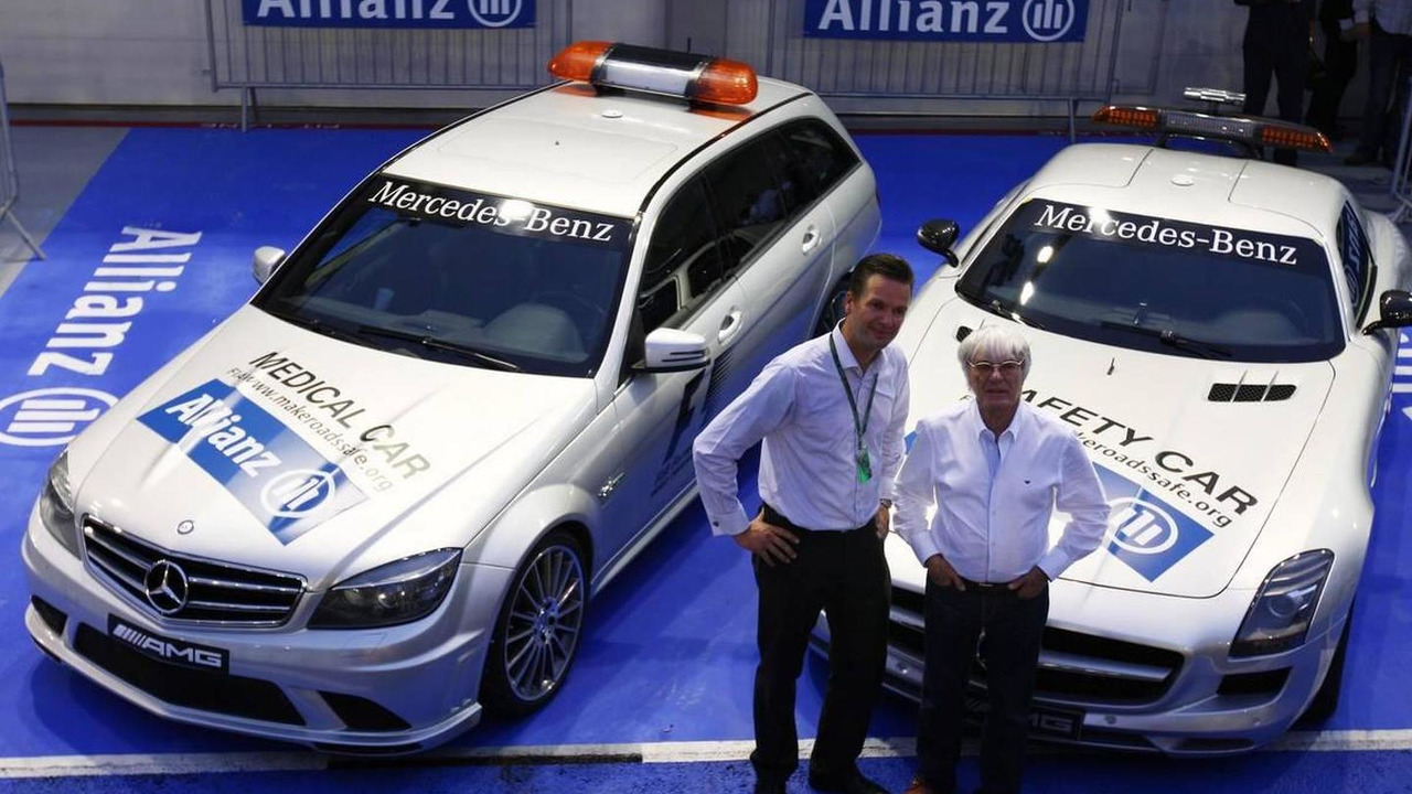 Dr Christian Deuringer, Vice president of Allianz SE, Bernie Ecclestone (GBR) and the Safety and medical cars - Formula 1 World Championship, Rd 15, Singapore Grand Prix, 23.09.2010