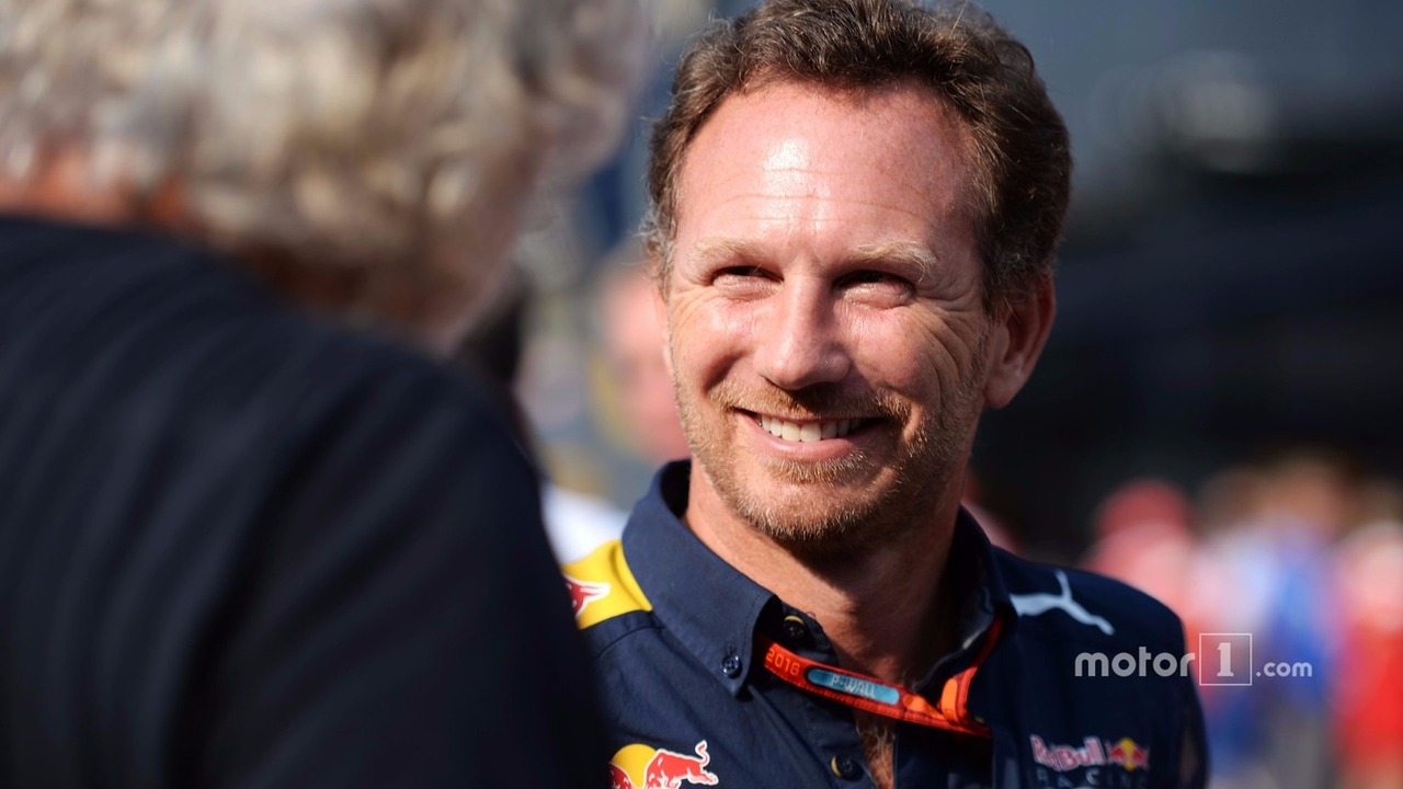 (L to R): Flavio Briatore with Christian Horner, Red Bull Racing Team Principal