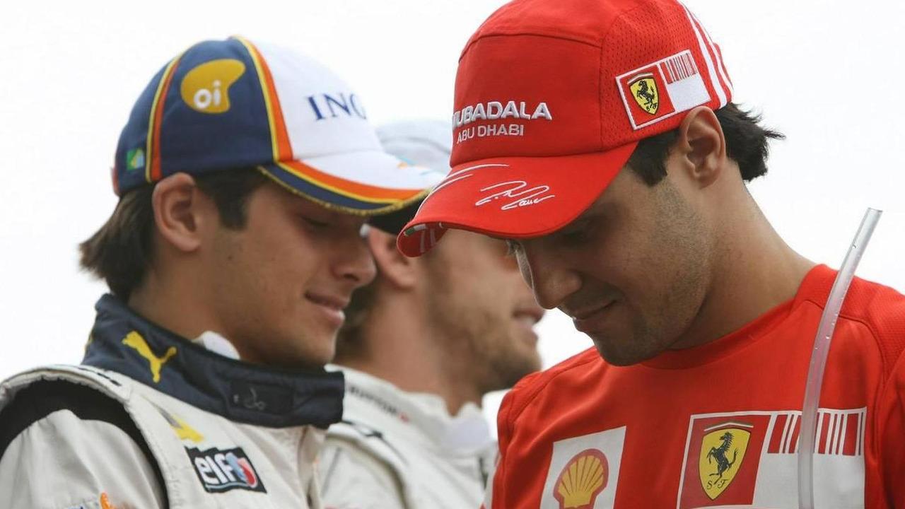 Felipe Massa (BRA), Scuderia Ferrari and Nelson Piquet Jr (BRA), Renault F1 Team, Brazilian Grand Prix, 02.11.2008 Sao Paulo, Brazil