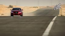 Jaguar XJR races man on jet pack